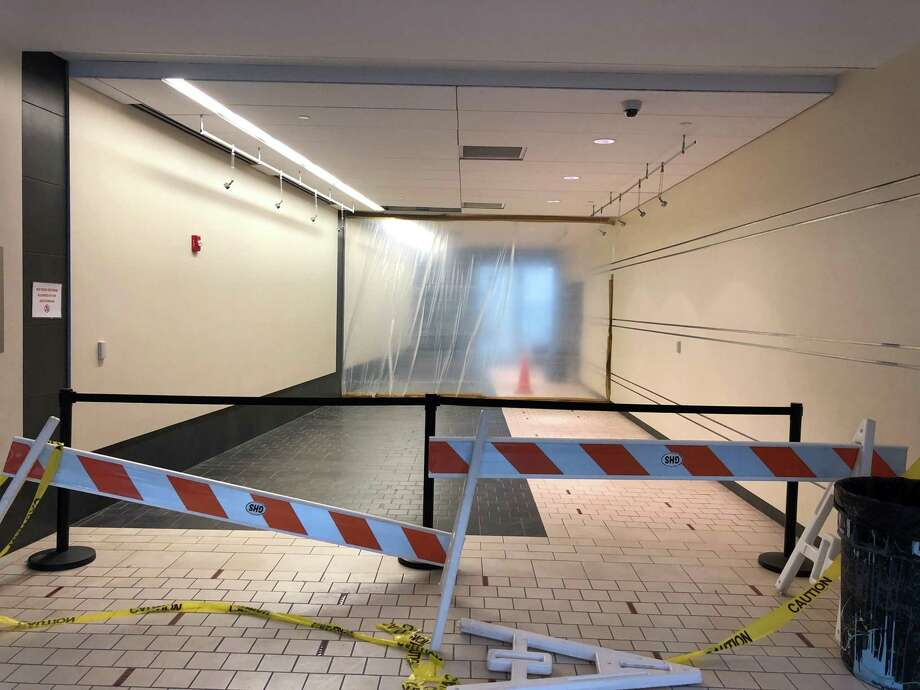 The hallway is blocked at Greenwich High School after a broken pipe caused a flood earlier this week. This show the intersection of the PAC hallway and the science hallway on Friday. Photo: Chiara Rissola / Contributed Photo