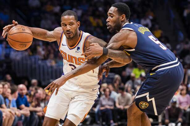 DENVER, CO - OCTOBER 20: Trevor Ariza #3 of the Phoenix Suns tries to dribble past Will Barton #5 of the Denver Nuggets during the first half at Pepsi Center on October 20, 2018 in Denver, Colorado. NOTE TO USER: User expressly acknowledges and agrees that, by downloading and or using this photograph, User is consenting to the terms and conditions of the Getty Images License Agreement. (Photo by Timothy Nwachukwu/Getty Images)