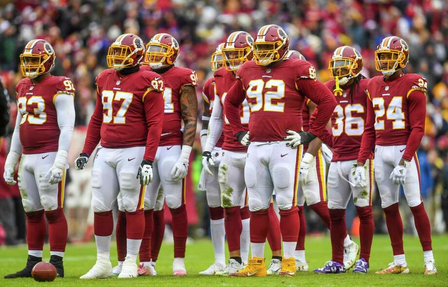 The Redskins defense in between plays during the game against the New York Giants at FedEx Field. Photo: Washington Post Photo By Toni L. Sandys / The Washington Post