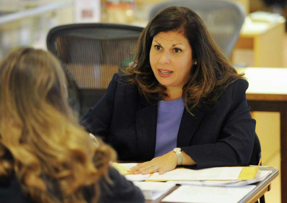 Commission on Aging Director Lori Contadino discusses plan options at free Medicare counseling at the Greenwich Library on Oct. 15, 2015. Photo: Tyler Sizemore / Hearst Connecticut Media / Greenwich Time