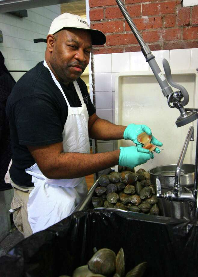 Erik Preston takes care of the clams at Frank Pepe Pizzeria Napoletana in New Haven. Photo: Christian Abraham / Hearst Connecticut Media / Connecticut Post