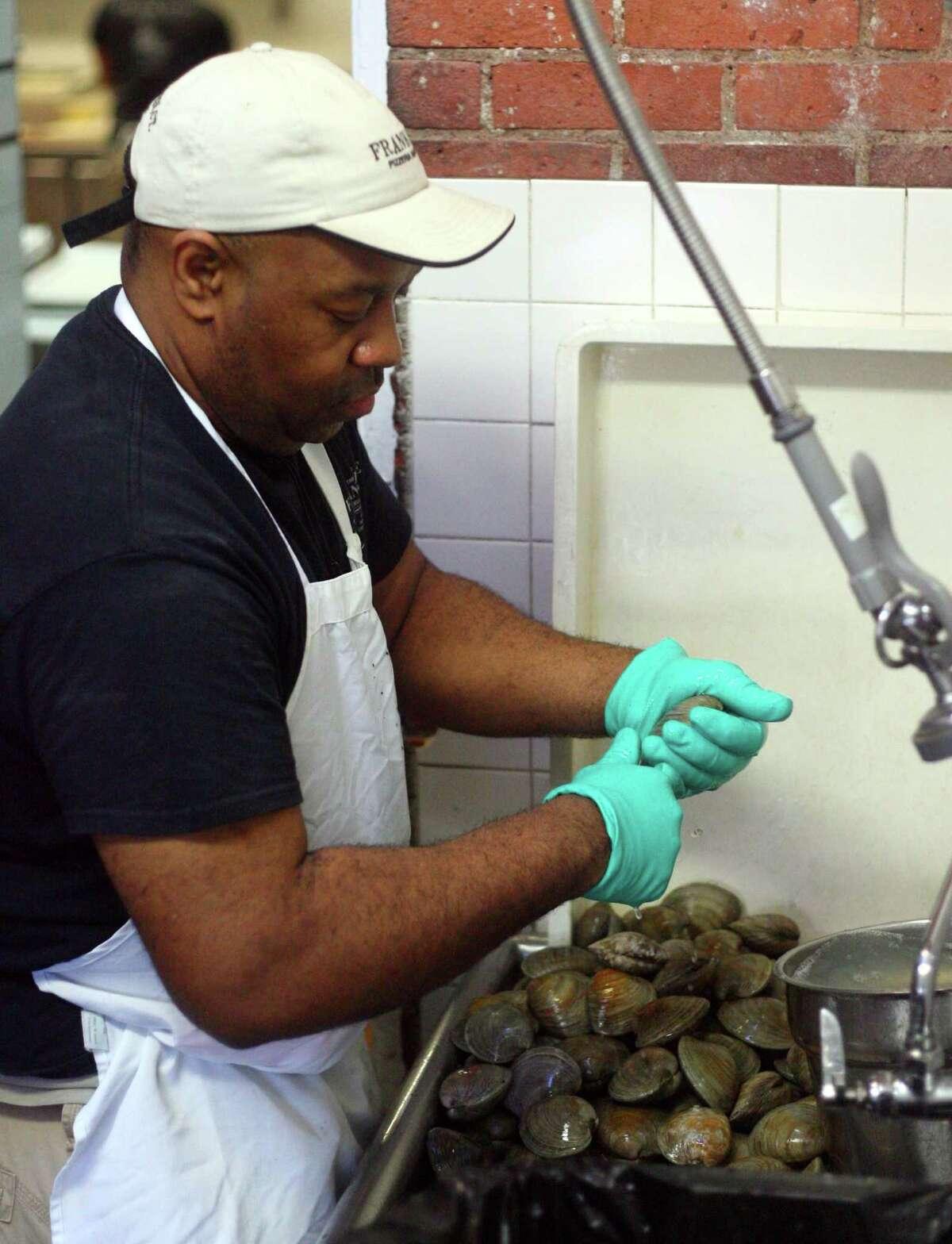 Erik Preston takes care of the clams at Frank Pepe Pizzeria Napoletana in New Haven.