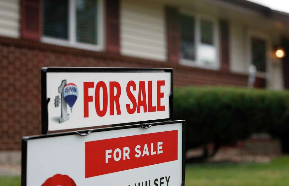 FILE- In this Oct 2, 2018, file photo a for sale sign stands outside a home on the market in the north Denver suburb of Thornton, Colo. Entry-level homes are hard to find. As a homebuyer, you can broaden your search by considering homes in need of improvement. (AP Photo/David Zalubowski, File) Photo: David Zalubowski / Copyright{2018} The Associated Press. All rights reserved.