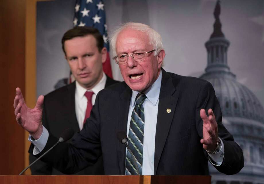 Sen. Bernie Sanders, I-Vt., joined at left by Sen. Chris Murphy, D-Conn., holds a news conference after the Senate passed a resolution he introduced that would pull assistance from the Saudi-led war in Yemen, a measure to rebuke Saudi Arabia after the killing of journalist Jamal Khashoggi, at the Capitol in Washington, Thursday, Dec. 13, 2018. (AP Photo/J. Scott Applewhite) Photo: J. Scott Applewhite / Copyright 2018 The Associated Press. All rights reserved