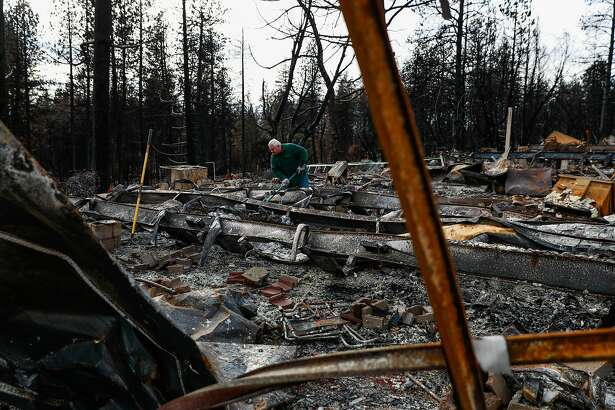 Stan Sorensen helps his sister (not pictured) look through her property which was destroyed by the Camp Fire in Paradise, California, on Wednesday, Dec. 5, 2018. The area off of Pentz Road had its evacuation order lifted today.