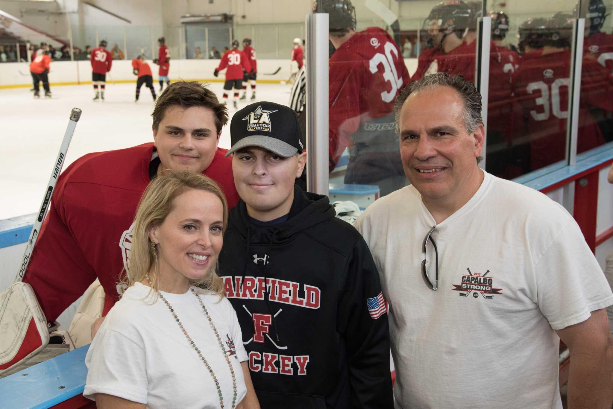 Charlie Capalbo, former Fairfield Co-op hockey goalie fighting