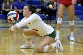 The Woodlands?' Georgia Murphy (5) returns a hit during the second set of a District 15-6A high school volleyball match at Klein High School, Tuesday, Oct. 9, 2018, in Spring.