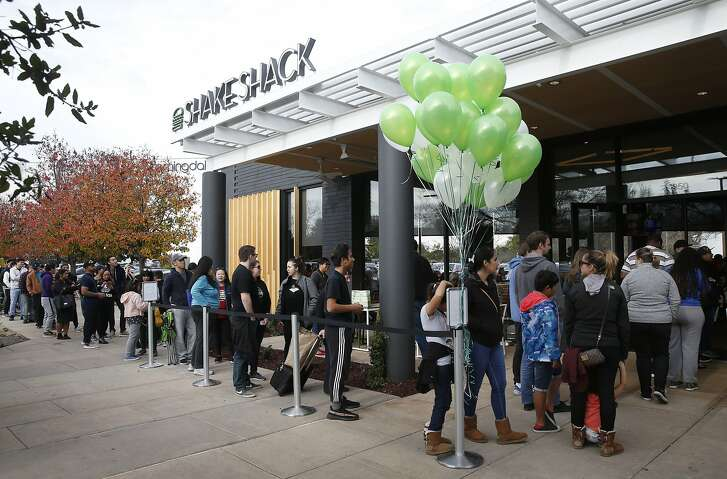 Hundreds of Shake Shack fans wait in a long line to get inside the restaurant's first Northern California location at the Stanford Shopping Center in Palo Alto, Calif. on Saturday, Dec. 15, 2018.