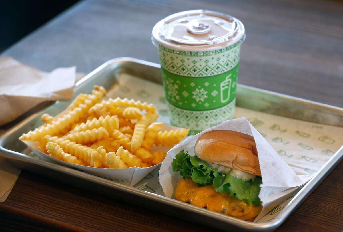 A classic Shack Burger, krinkle cut fries and chocolate shake is served at the first Shake Shack restaurant in Northern California which opened at the Stanford Shopping Center in Palo Alto, Calif. on Saturday, Dec. 15, 2018.
