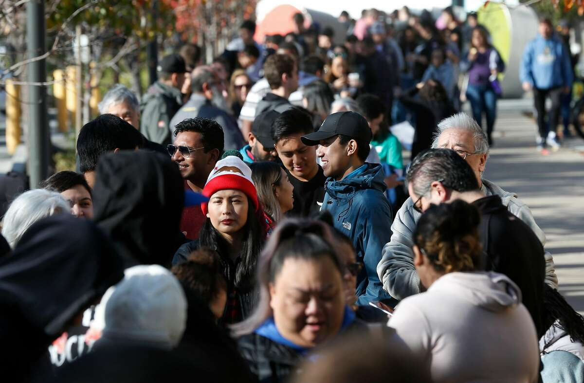 Hundreds of Shake Shack fans wait in a long line for the restaurant's first Northern California location to open at the Stanford Shopping Center in Palo Alto, Calif. on Saturday, Dec. 15, 2018.
