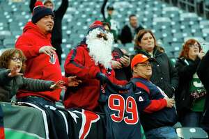 Houston Texans fans watch warm ups before an NFL football game against the New York Jets at MetLife Stadium on Saturday, Dec. 15, 2018, in East Rutherford, N.J.