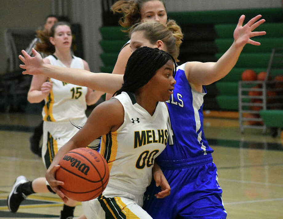 Metro-East Lutheran point guard Destiny Williams drives to the basket in the second quarter against Brussels on Saturday in Edwardsville. Photo: Matt Kamp/Intelligencer