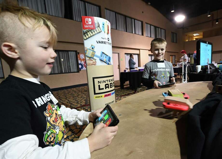 Parker Gordon, 7, and Tommy Rau, 6, face off in a bot clash as the learn the basic principals of coding at the 30th Annual Technology Awareness Day held at the Red Lion Hotel Friday Dec.14, 2018 in Colonie, N.Y. Gordon and Riu are from Bradt Primary School at Mohonason School District and they were using build-yourself bot from Nintendo LABO. (Skip Dickstein/Times Union) Photo: SKIP DICKSTEIN / 20045679A