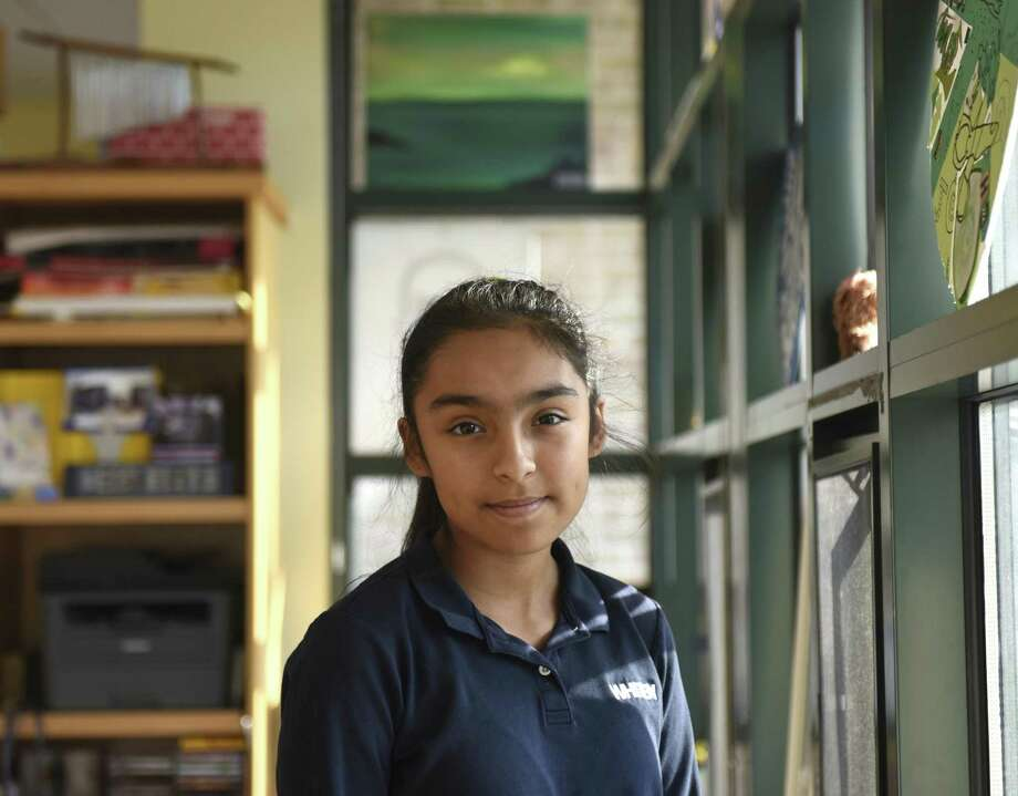 "Kaitlyn Sandoval-Diaz poses in the design lab at Whitby School in Greenwich, Conn. Thursday, Dec. 6, 2018. Sandoval-Diaz produces a student run video series called ""What's Up Whitby"" and is also a founder of a student group called the Rookie Wookies, who participate in public service projects and recently raised nearly $2000 for UNICEF Kid Power. Photo: Tyler Sizemore / Hearst Connecticut Media / Greenwich Time"