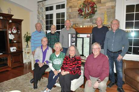 """Ginny Rucinski Charbonneau hosted a reunion of the Shenendehowa Hiking Club at her home Dec. 15, 2018. Eight club members and one teacher were able to attend. Pictured are, top row from left: Peter Medick, of Clifton Park, Stephen Hayes of Canastota, Eric """"Rick"""" Mogren of Portland, Oregon, Daniel Willa of Cape Cod, and Keith Dayer of Schenectady. First row: Janice Naylon Waller of Greenwich, Charbonneau of Halfmoon, Gail Charlson of Albany and Garry Boynton of Ballston Lake. Photo: Joyce Bassett, Times Union"""