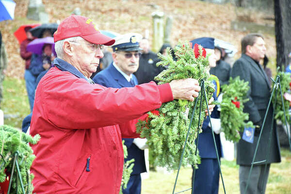 Retired U.S. Marine Corps Sgt. Maj. Sam Roberts places the wreath honoring all fallen U.S. Marines at Saturday's Wreaths Across America program at Alton National Cemetery.