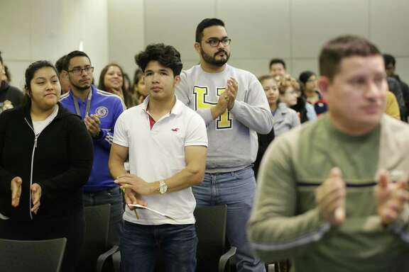 People give a standing ovation after the keynote speech by Jose Luis Zelaya, a PhD candidate at Texas A&M, during the fourth annual Dream Summit held at HISD Hattie Mae White Educational Support Center, 4400 W. 18th St., Saturday, Dec. 15, 2018, in Houston.