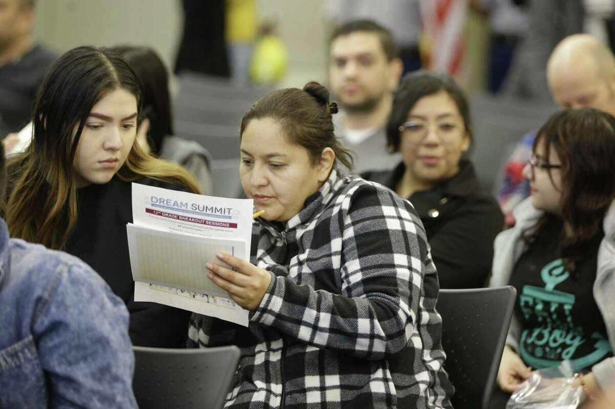 Rosa Ortis, left, and her mother, who she shares the same name, Rosa Ortis, right, attend the fourth annual Dream Summit held at HISD Hattie Mae White Educational Support Center, 4400 W. 18th St., Saturday, Dec. 15, 2018, in Houston.