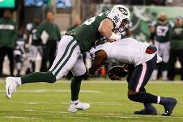 New York Jets defensive end Henry Anderson (96) sacks Houston Texans quarterback Deshaun Watson (4) during the first quarter of an NFL football game at MetLife Stadium on Saturday, Dec. 15, 2018, in East Rutherford, N.J.