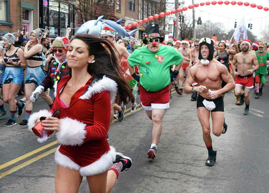 The Albany Society for the Advancement of Philanthropy hosts the 13th Annual Santa Speedo Sprint to benefit the Albany Damien Center and the HIV/AIDS program at Albany Medical Center Saturday Dec. 15, 2018 in Albany, NY.  (John Carl D'Annibale/Times Union) Photo: John Carl D'Annibale / 20045704A