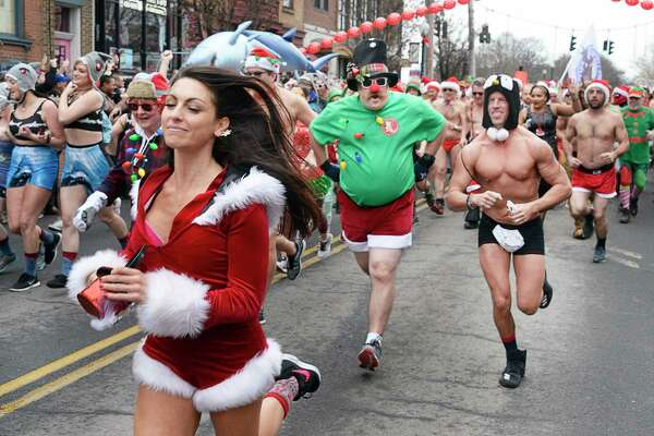 The Albany Society for the Advancement of Philanthropy hosts the 13th Annual Santa Speedo Sprint to benefit the Albany Damien Center and the HIV/AIDS program at Albany Medical Center Saturday Dec. 15, 2018 in Albany, NY. (John Carl D'Annibale/Times Union)