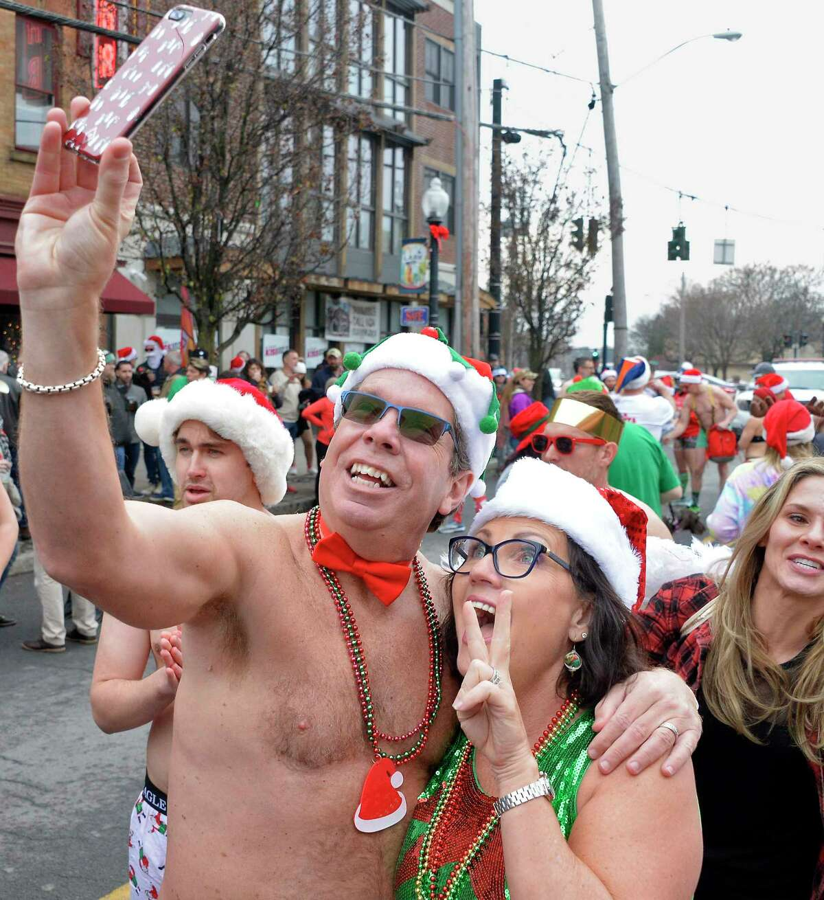 Husband and wife Jerry and Jen Pittz of Guilderland snap a selfie before the start of the 13th Annual Santa Speedo Sprint to benefit the Albany Damien Center and the HIV/AIDS program at Albany Medical Center Saturday Dec. 15, 2018 in Albany, NY. (John Carl D'Annibale/Times Union)