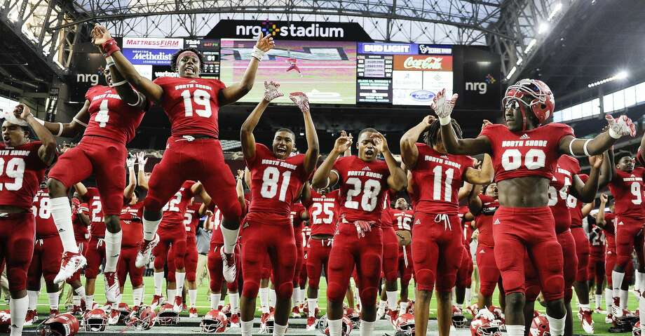 North Shore's (l to r) Jordan Polart, AJ Carter, Shadrach Banks, Ismael Fuller, Zorhan Rideaux, Joseph Wilson, and Deidrick Cole celebrate the team's win over Lake Travis in a 6A Division 1 state semi-final high school football playoff game, Saturday, Dec. 15, 2018, in Houston. North Shore won the game, 51-10. Photo: Eric Christian Smith/Contributor