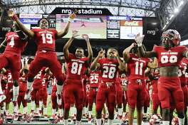 North Shore's (l to r) Jordan Polart, AJ Carter, Shadrach Banks, Ismael Fuller, Zorhan Rideaux, Joseph Wilson, and Deidrick Cole celebrate the team's win over Lake Travis in a 6A Division 1 state semi-final high school football playoff game, Saturday, Dec. 15, 2018, in Houston. North Shore won the game, 51-10.