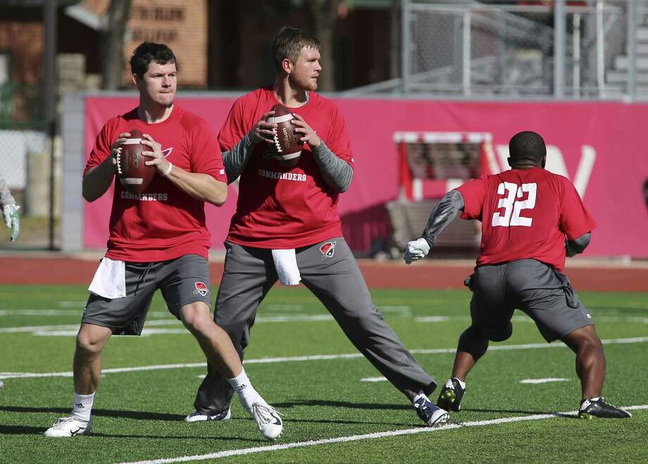 Quarterbacks Dustin Vaughan (center) and Logan Woodside drop back for passes as the San Antonio Commanders hold mini-camp at UIW Tom Benson Football Stadium on Thursday, Dec. 13, 2018. Photo: Kin Man Hui /San Antonio Express-News / ©2018 San Antonio Express-News