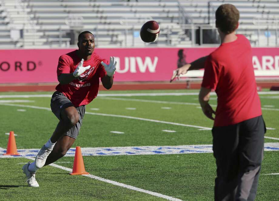 Wide receiver Carl Whitley take part in drills as the San Antonio Commanders hold mini-camp at UIW Tom Benson Football Stadium on Thursday, Dec. 13, 2018. The Commanders are part of the newly created Alliance of American Football league which will kick off with eight teams starting on February 9. The Commanders' home games will be held at the Alamodome and are expected to play 10 games in the regular season. The team is overseen by General Manager Daryl Johnston who is a former Dallas Cowboys fullback. Head coach is Mike Riley who formerly coached the San Antonio Riders from 1991-1992. (Kin Man Hui/San Antonio Express-News) Photo: Kin Man Hui, Staff Photographer / San Antonio Express-News / ©2018 San Antonio Express-News
