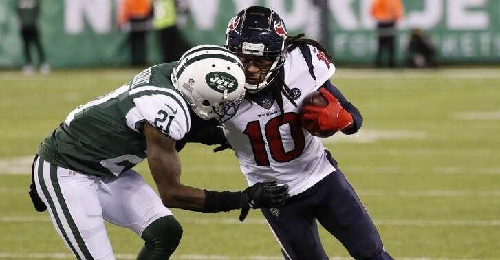Houston Texans wide receiver DeAndre Hopkins (10) is hit by New York Jets cornerback Morris Claiborne (21) as he makes a first down reception down the sidelines during the first quarter of an NFL football game at MetLife Stadium on Saturday, Dec. 15, 2018, in East Rutherford, N.J.