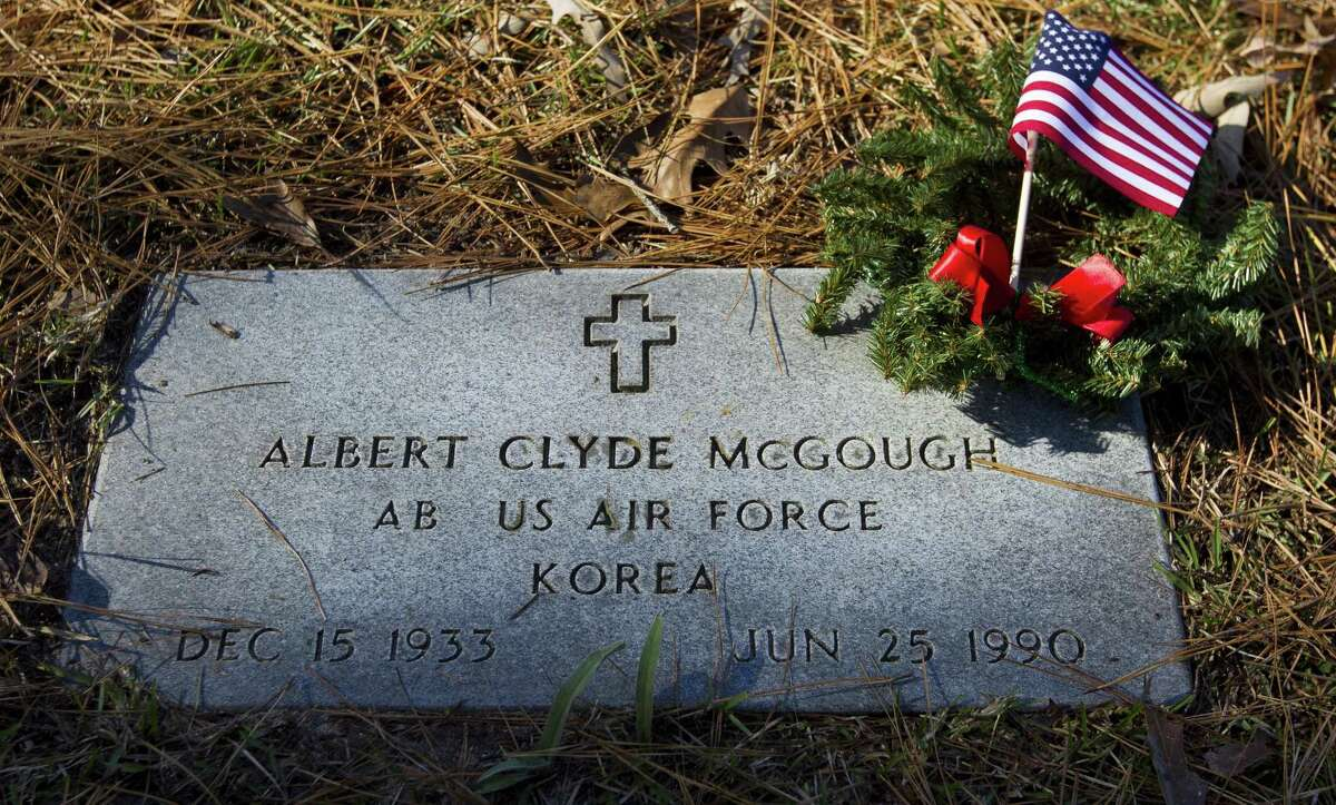 The grave of Korean War veteran Albert McGough is seen adorned with a Christmas wreath as members of the Willis community along with American Legion Post 618 took part in the annual laying of wreaths on the graves of veterans, Saturday, Dec. 15, 2018, in Willis.