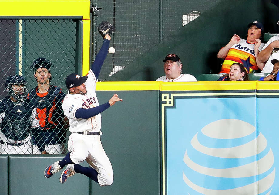 Houston Astros George Springer (4) fails to catch a long fly ball double from Boston Red Sox catcher Christian Vazquez (7) during the sixth inning of Game 4 of the American League Championship Series at Minute Maid Park on Wednesday, Oct. 17, 2018, in Houston. Photo: Brett Coomer/Staff Photographer / ? 2018 Houston Chronicle