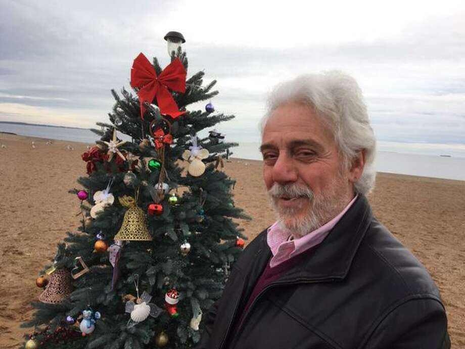 West Havener Sal Schaivone wasn't thinking about creating a community Christmas focal point when he decided to plant an lifelike artificial blue spruce Christmas tree out on Dawson Avenue Beach. He just wanted to pay tribute to his late wife of more than 48 years, Donna Schiavone, who died last year. But his neighbors -- and some people who have never met him -- had other ideas. Photo: Mark Zaretsky / Hearst Connecticut Media /