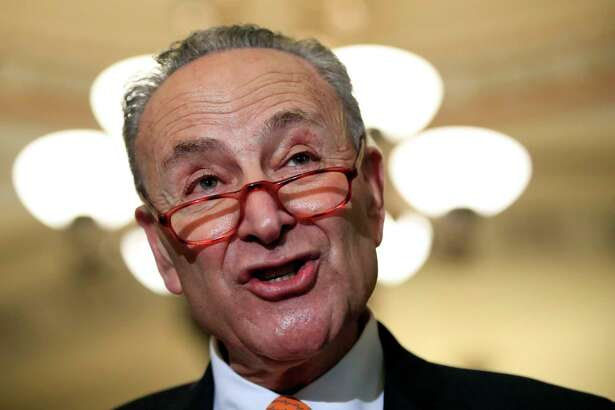 In this Dec. 11, 2018 photo, Senate Minority Leader Chuck Schumer, D-N.Y., speaks to reporters on Capitol Hill in Washington. Parties and Christmas cookies only soothe so much in the chilly Capitol after two years of President Donald Trump?'s provocations, dramas like Supreme Court Justice Brett Kavanaugh?'s confirmation and the elections that flipped the House majority to Democrats. Everyone wants to go home, yet both chambers were scheduled to be in session next week over hefty matters, including the budget and criminal sentencing reform. (AP Photo/Manuel Balce Ceneta)