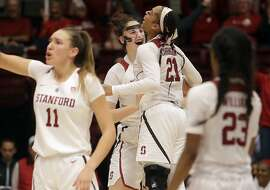 Stanford center Shannon Coffee, center left, and guard Dijonai Carrington (21) celebrate during the second half of an NCAA college basketball game against Baylor in Stanford, Calif., Saturday, Dec. 15, 2018. (AP Photo/Jeff Chiu)