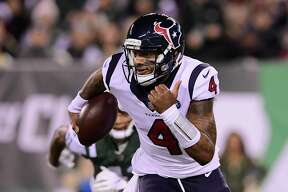 Quarterback Deshaun Watson (4) of the Houston Texans runs the ball against the New York Jets during the third quarter at MetLife Stadium on December 15, 2018 in East Rutherford, New Jersey.