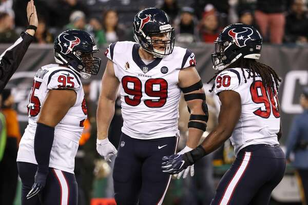 Houston Texans defensive ends Christian Covington (95), J.J. Watt (99) and outside linebacker Jadeveon Clowney (90) celebrate after Watt sacked New York Jets quarterback Sam Darnold during the first quarter of an NFL football game at MetLife Stadium on Saturday, Dec. 15, 2018, in East Rutherford, N.J.