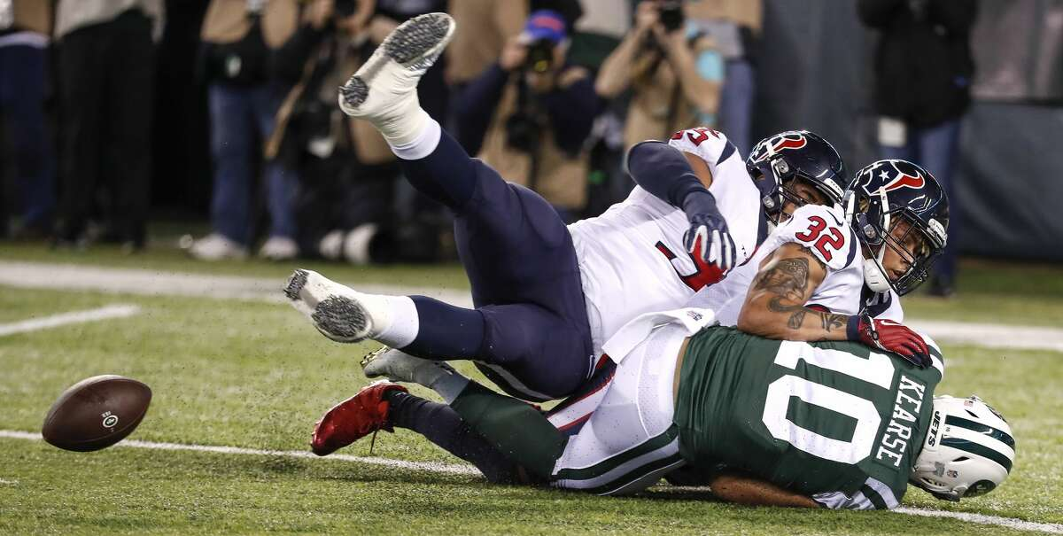 Houston Texans free safety Tyrann Mathieu (32) and defensive end Christian Covington (95) break up a pass intended for New York Jets wide receiver Jermaine Kearse (10) during the first quarter of an NFL football game at MetLife Stadium on Saturday, Dec. 15, 2018, in East Rutherford, N.J.