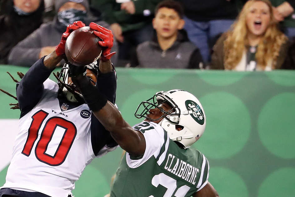 Houston Texans wide receiver DeAndre Hopkins (10) beats New York Jets cornerback Morris Claiborne (21) for a 14-yard touchdown reception during the fourth quarter of an NFL football game at MetLife Stadium on Saturday, Dec. 15, 2018, in East Rutherford, N.J.