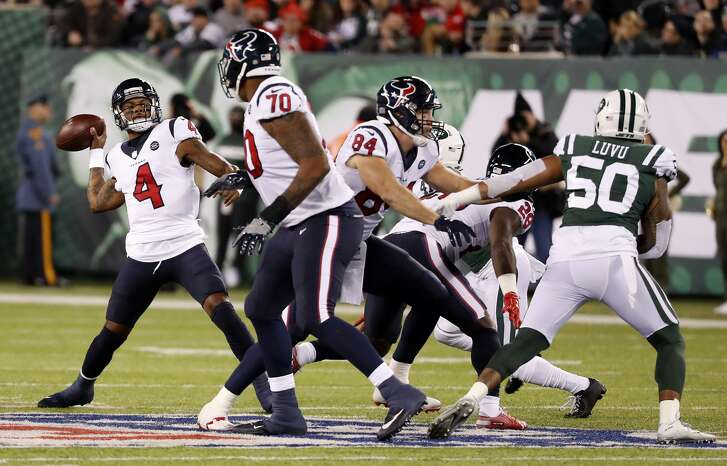 Houston Texans quarterback Deshaun Watson (4) rears back to throw a 45-yard touchdown pass to wide receiver DeAndre Hopkins (10) against the New York Jets during the second quarter of an NFL football game at MetLife Stadium on Saturday, Dec. 15, 2018, in East Rutherford, N.J.