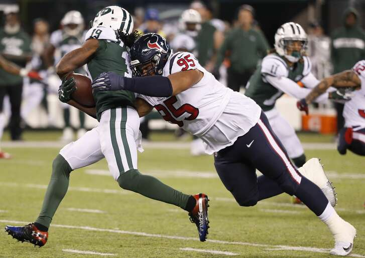 Houston Texans defensive end Christian Covington (95) stops New York Jets wide receiver Andre Roberts (19) short of a first down during the third quarter of an NFL football game at MetLife Stadium on Saturday, Dec. 15, 2018, in East Rutherford, N.J.
