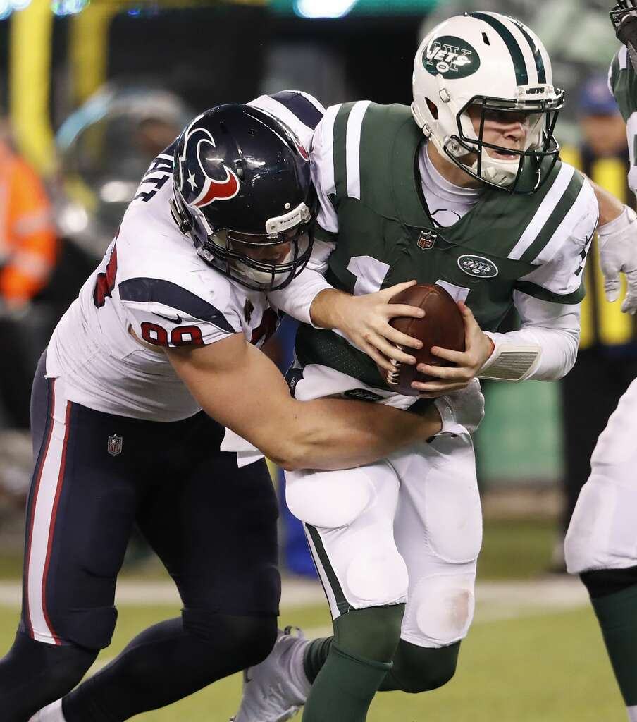 <p>Houston Texans defensive end J.J. Watt (99) sacks New York Jets quarterback Sam Darnold (14) during the fourth quarter of an NFL football game at MetLife Stadium on Saturday, Dec. 15, 2018, in East Rutherford,</p>