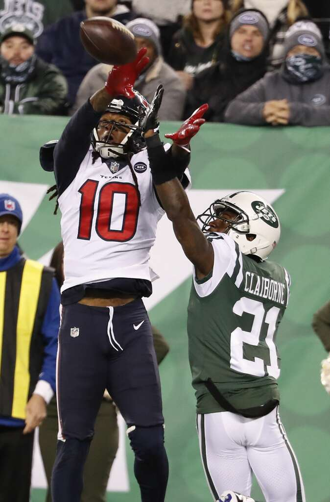 <p>Houston Texans wide receiver DeAndre Hopkins (10) beats New York Jets cornerback Morris Claiborne (21) for a 14-yard touchdown reception during the fourth quarter of an NFL football game at MetLife Stadium on</p>