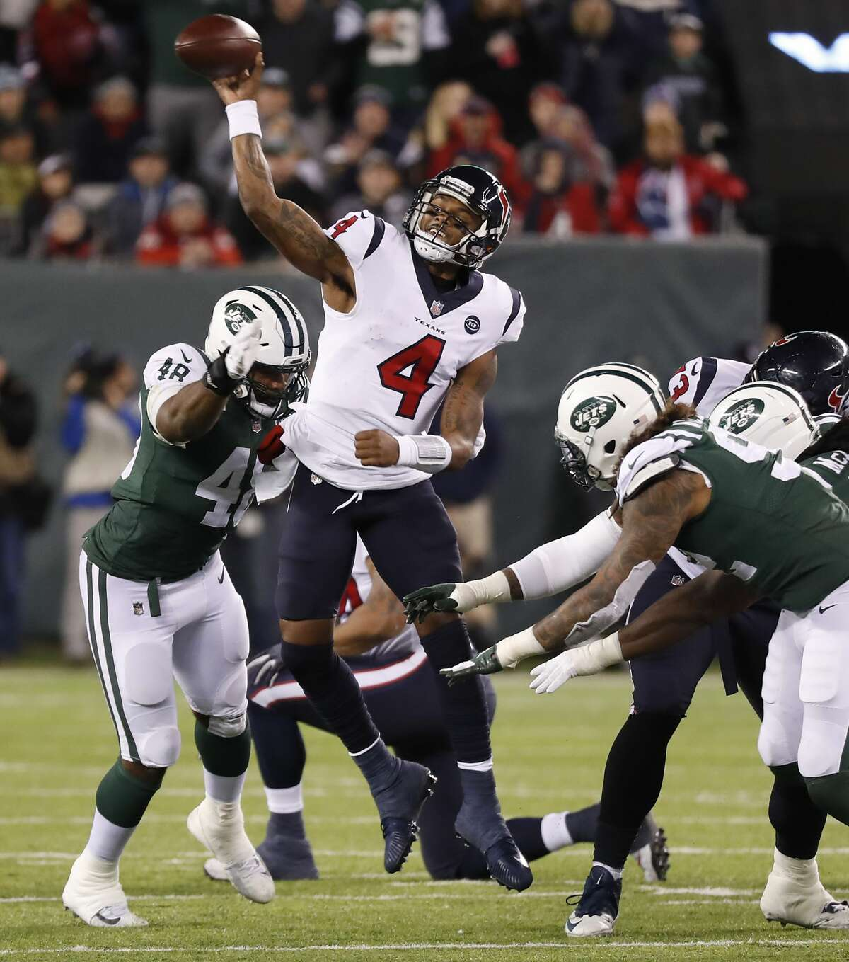 Houston Texans quarterback Deshaun Watson (4) makes a throw as he is hit by New York Jets outside linebacker Jordan Jenkins (48) during the fourth quarter of an NFL football game at MetLife Stadium on Saturday, Dec. 15, 2018, in East Rutherford, N.J.
