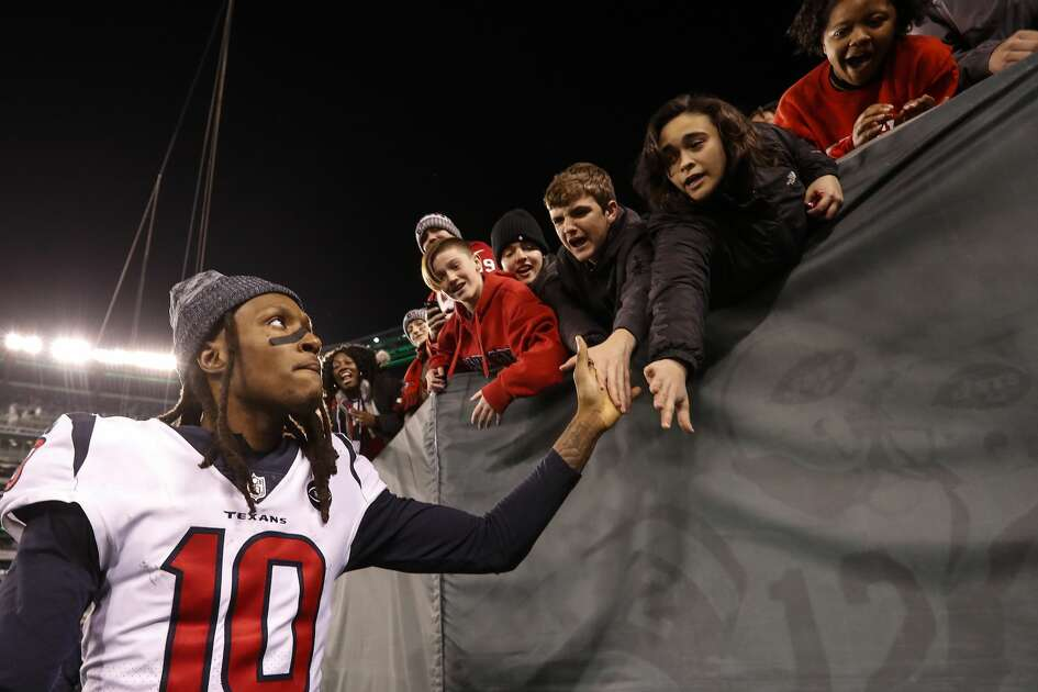 Houston Texans wide receiver DeAndre Hopkins (10) high fives fans as he leaves the field after the Texans 29-22 win over the New York Jets at MetLife Stadium on Saturday, Dec. 15, 2018, in East Rutherford, N.J.