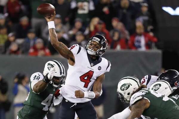 Texans quarterback Deshaun Watson gets off a pass while under pressure from the Jets' defense, imcluding outside linebacker Jordan Jenkins, left, during the fourth quarter.