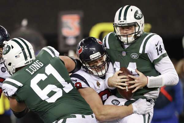 Texans defensive end J.J. Watt (99) sacks Jets quarterback Sam Darnold (14) in the fourth quarter of Saturday's game at East Rutherford, N.J. Watt finished with two sacks and a forced fumble.