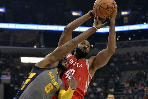 Houston Rockets center Nene Hilario (42) and Memphis Grizzlies guard Shelvin Mack (6) in the first half of an NBA basketball game Saturday, Dec. 15, 2018, in Memphis, Tenn. (AP Photo/Brandon Dill)