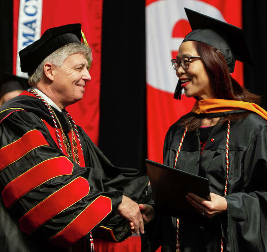 Southern Illinois University Edwardsville Chancellor Randy Pembrook, Ph.D., left, shakes the hand of a newly eligible graduate during the 2018 Fall Commencement exercises, which were Friday and Saturday in the Vadalabene Center at SIUE. Photo: For The Intelligencer